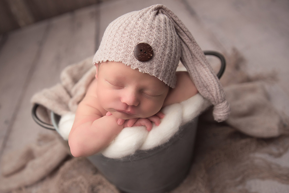 adorable newborn baby boy posing for joanna andres during photo shoot